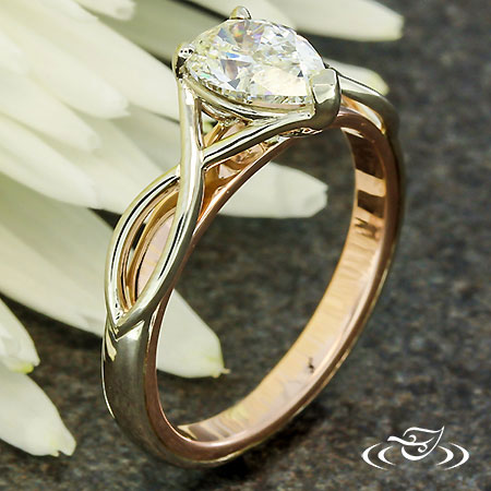 TWISTING TWO TONE ENGAGEMENT RING