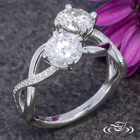 TWISTING TWO STONE ENGAGEMENT RING