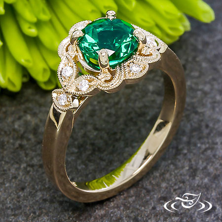 YELLOW GOLD AND EMERALD ANTIQUE HALO ENGAGEMENT RING