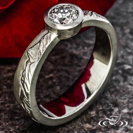 DIAMOND BEZEL MOUNTAIN ENGAGEMENT RING