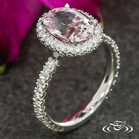 PINK SAPPHIRE AND FRENCH SET HALO ENGAGEMENT RING