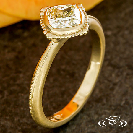 YELLOW DIAMOND FULL BEZEL RING.