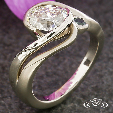 CONTEMPORARY OVAL CUT ENGAGEMENT RING