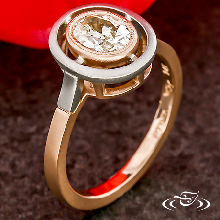 CONTEMPORARY PLATINUM & ROSE GOLD HALO ENGAGEMENT RING