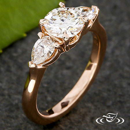 Three Stone Round And Pear Diamond Engagement Ring
