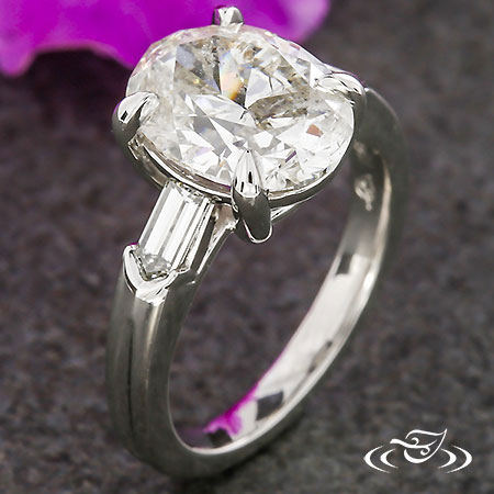 OVAL AND BAGUETTE DIAMOND ENGAGEMENT RING