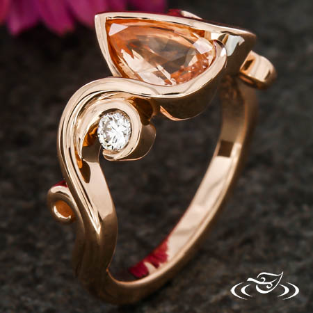Rose Gold And Pear Sapphire Swirl Engagement Ring