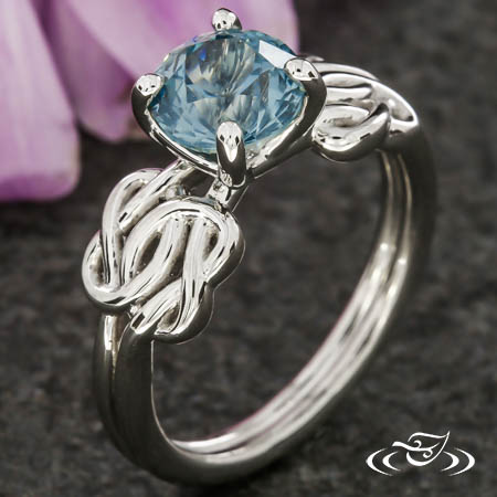 MONTANA SAPPHIRE LOVER'S KNOT ENGAGEMENT RING