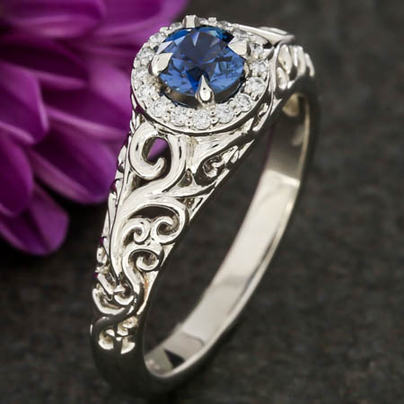 Blue Sapphire Halo And Swirl Engagement Ring