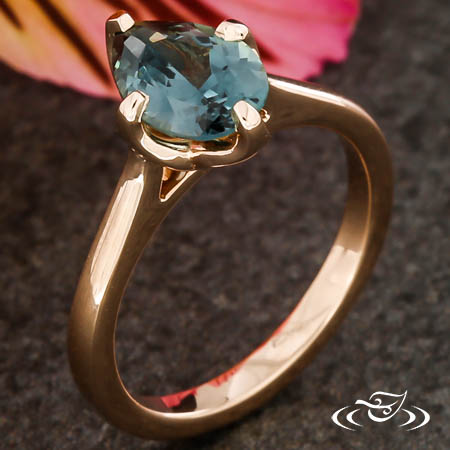 Tulip Solitaire With A Montana Pear-Shaped Sapphire