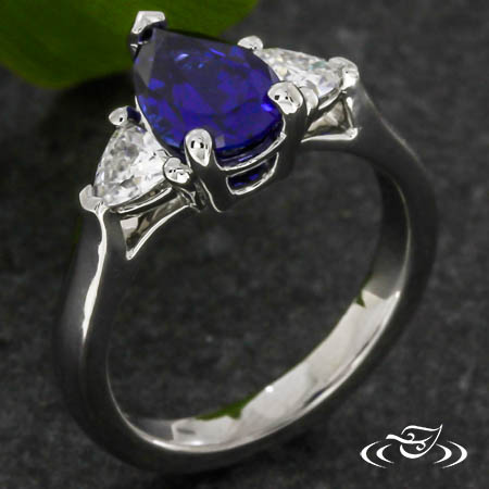 Pear And Trillion Three Stone Ring