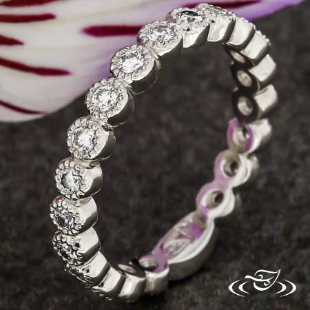Platinum Band With Bezel Set Diamonds And Millgrain Detailing