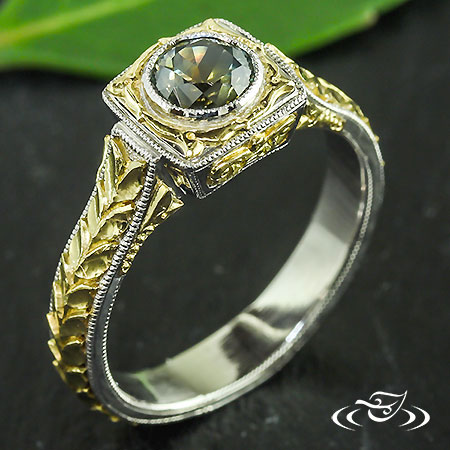 ONE OF A KIND PLATINUM AND 18KT GOLD DIAMOND RING