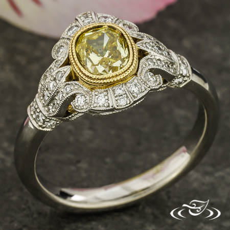 PLATINUM AND 18KT YELLOW GOLD ANTIQUE STYLE RING